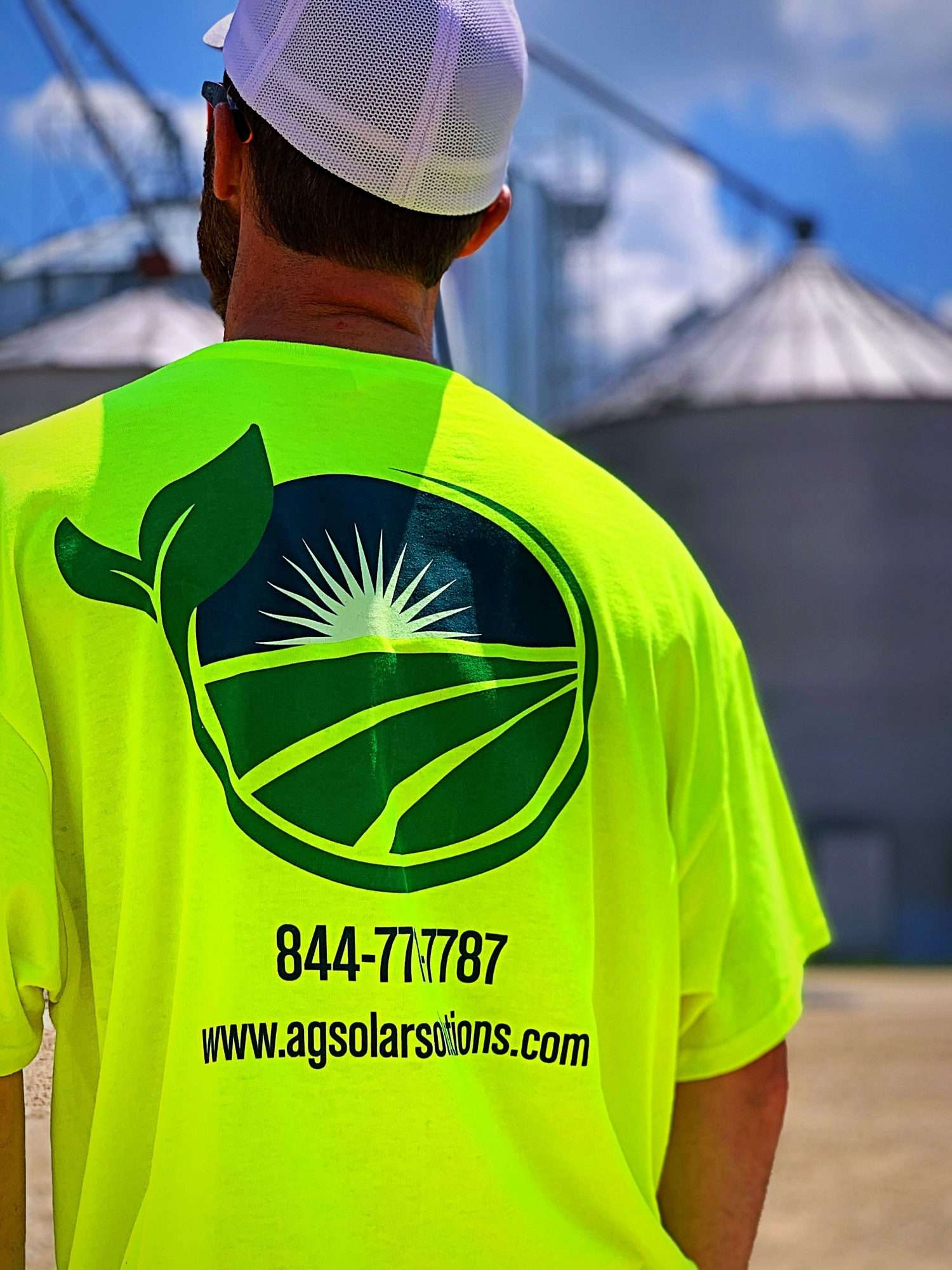 Ag Solar Solutions worker looking out over a farm