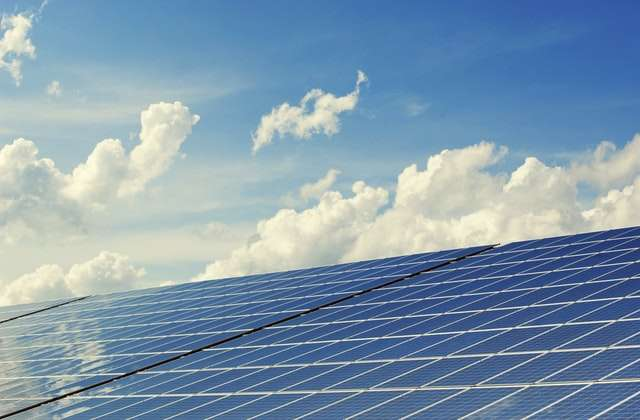 solar panels next to a blue sky