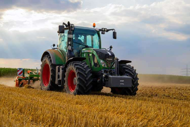 tractor in a field with crops
